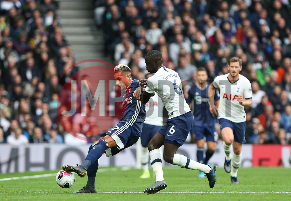 Roberto Pereyra of Watford holds the ball up under pressure from Davinson Sanchez of Tottenham Hotspur - Mandatory by-line: Arron Gent/JMP - 19/10/2019 - FOOTBALL - Tottenham Hotspur Stadium - London, England - Tottenham Hotspur v Watford - Premier League