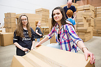 Repro Free: The People Build. In preparation for the spectacular architectural event devised by french artist Olivier Grossetete , The people of Galway are preparing 4,000  cardboard  boxes for a new structure built by the people (Saturday) and demolished by the   people on Sunday.<br /> Lara Clifford and Joanne Murray from Ballinasloe  Galway helping out with the build.<br />  .  Photo:Andrew Downes, xposure