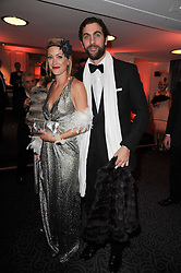 HUGH VAN CUTSEM and his wife ROSE at Quintessentially's 10th birthday party held at The Savoy Hotel, London on 13th December 2010.