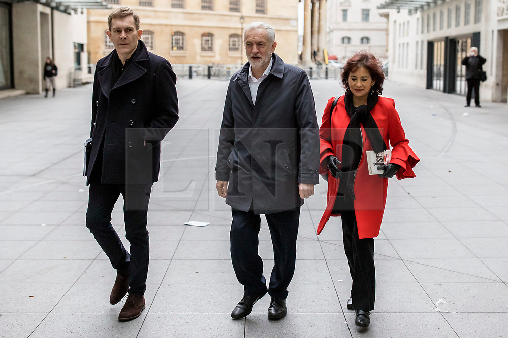 © Licensed to London News Pictures. 13/01/2019. London, UK. Leader of the Labour Party Jeremy Corbyn MP (C), his wife Laura Alvarez (R) and Labour Party Executive Director of Strategy and Communications Seamus Milne (L) arrive at BBC Broadcasting House to appear on The Andrew Marr Show. Photo credit: Rob Pinney/LNP