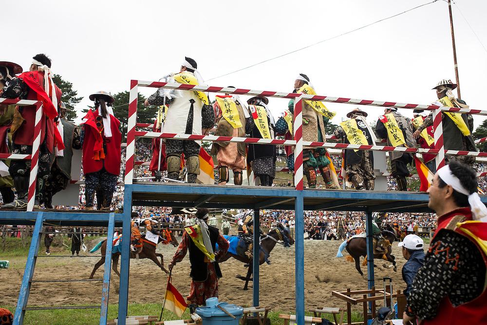 "MINAMISOMA, JAPAN - JULY 24 :  A samurai horsemen compete in the Kacchu-keiba (armed horse race) during the Soma Nomaoi festival at Hibarigahara field on Sunday, July 24, 2016 in Minamisoma, Japan. ""Soma-Nomaoi"" is a traditional festival that recreates a samurai battle scene from more than 1,000 years ago. (Photo: Richard Atrero de Guzman/NURPhoto)"