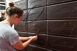 A chocolatier puts the finishing touches to a chocolate wall, at The Chocolate Show, at Olympia in Kensington, London.  Picture date: Friday October 13th, 2017. Photo credit should read: Matt Crossick/ EMPICS Entertainment.
