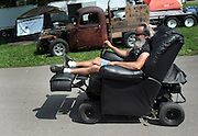 David W. Smith/ Daily News<br /> Al Karlowitsch from Hickory, NC drives around on his motorized recliner during the Hot Rod Reunion Thursday at Beech Bend Campground. In the background is Albert and Margaret Springer from Henderson, TN in their 1946 Chevrolet truck.