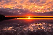 Clouds refelected in Namekus Lake at sunrise<br /> Prince Albert National Park<br /> Saskatchewan<br /> Canada