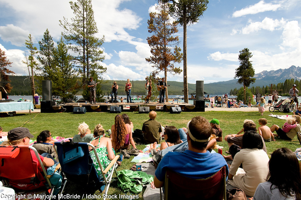 People enjoying live outdoor Music From Stanley at Red Fish Lake Lodge during summer in Stanley, Idaho.