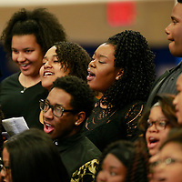 THOMAS WELLS | BUY at PHOTOS.DJOURNAL.COM<br /> Members of the choir sign the Black National Anthem as the Black History Program gets started at Tupelo High School on Tuesday.