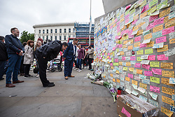 © Licensed to London News Pictures. 08/06/2017. London, UK. People read messages left on a wall at London Bridge where eight people lost their lives in a terrorist attack on the evening of Saturday 3 June 2017. Photo credit: Rob Pinney/LNP