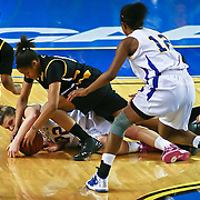 Delaware Sophomore Guard (#22) Lauren Carra &amp; Towson Charmonique Watt (#10) dives for the loose ball late in the second half, Carra finished with 10 points as Delaware defeated Towson 75-57 Wednesday at The Bob Carpenter Center In Newark Delaware.<br /> <br /> Special to The News Journal/SAQUAN STIMPSON
