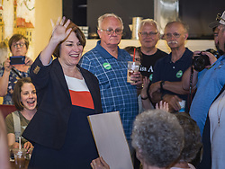 May 25, 2019 - Iowa Falls, Iowa, U.S - US Senator AMY KLOBUCHAR (D-MN), left, waves to the crowd as she walks into a campaign event in Iowa Falls. Sen. Klobuchar is touring Iowa this weekend to support her bid to be the Democratic nominee in 2020 for the US Presidency. Iowa traditionally hosts the the first election event of the presidential election cycle. The Iowa Caucuses will be on Feb. 3, 2020. (Credit Image: © Jack Kurtz/ZUMA Wire)
