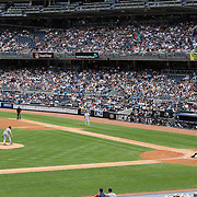 Alex Rodriguez hits a home run off Detroit Tigers pitcher Justin Verlander in front of a packed crowd at Yankee Stadium during the New York Yankees V Detroit Tigers MLB Regular season baseball game at Yankee Stadium, The Bronx, New York. 11th August 2013. Photo Tim Clayton