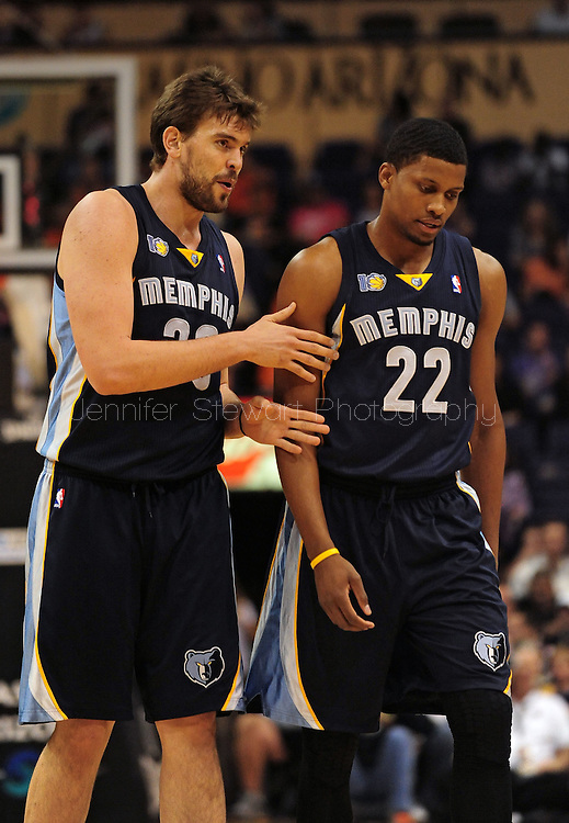 Nov. 5 2010; Phoenix, AZ, USA; Memphis Grizzlies center Marc Gasol (33) and teammate forward Rudy Gay (22) talk on the court during the first half at the US Airways Center.  The Suns defeated the Grizzlies in double over time 123-118.  Mandatory Credit: Jennifer Stewart-US PRESSWIRE.