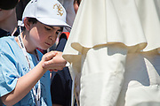 May 31, 2017 : A child kisses the hand of Pope Francis during the weekly general audience in Saint Peter's square at the Vatican. Antoine Mekary   Aleteia   I.Media