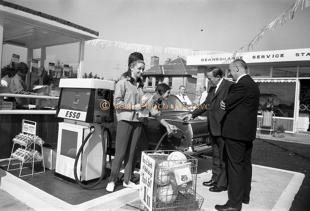 09/08/1967<br /> 08/09/1967<br /> 09 August 1967<br /> Opening of Esso service station at Dean's Grange, Dublin. The site was originally a sculptures yard was a 2-bay service station with the latest equipment. It was to be a 24 hours station and a 5-minute Car Wash and Electronic Tuning was available. Mr. P.J. Burke, T.D., Chairman, Dublin County Council, who opened the station, gets his car filled by the Esso attendants. On right is Mr. F.E. Morton, Branch Manager North, Esso. Customers who bought a £1 of petrol got a discount on a beach ball.