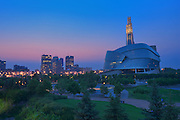 Canadian Museum for Human Rights (CMHR) with the city of Winnipeg in background at dusk<br /> Winnipeg<br /> Manitoba<br /> Canada