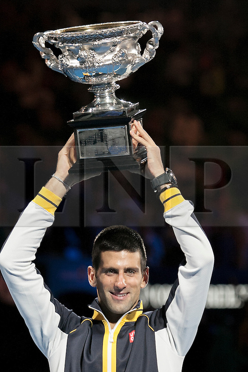 © Licensed to London News Pictures. 27/01/2013. Melbourne Park, Australia. Novak Djokovic lifts up the winners trophy during the Mens Final between Novak Djokovic and Andy Murray of the Australian Open. Photo credit : Asanka Brendon Ratnayake/LNP