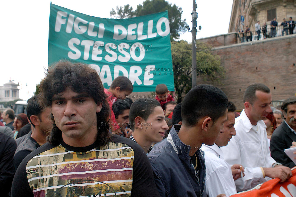 Rome  July 8 2008.Demonstrators protest against the discrimination of Roma and Sinti..The banner in the background reads 'Sons of the same father'