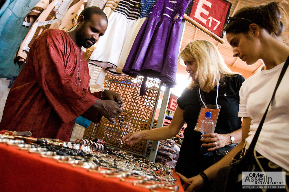 Visitors look at jewelry at the 22nd Salon International de l'Artisanat de Ouagadougou (SIAO) in Ouagadougou, Burkina Faso on Sunday November 2, 2008.