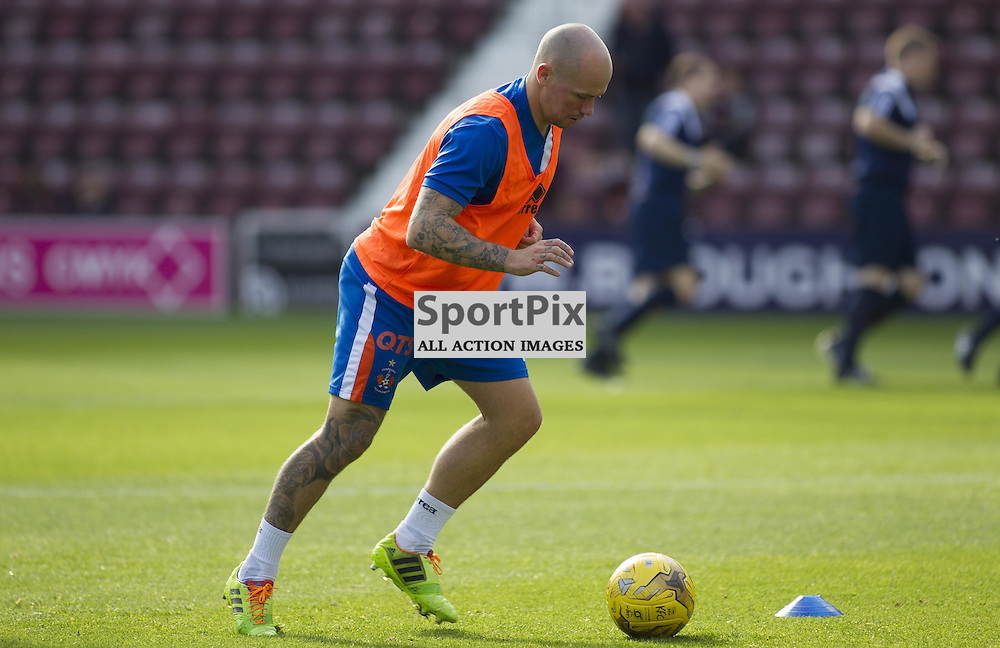 Former Hearts player Jamie Hamill of Kilmarnock warms up before the Ladbrokes Scottish Premiership match between Heart of Midlothian FC and Kilmarnock FC at Tynecastle Stadium on October 4, 2015 in Edinburgh, Scotland. Photo by Jonathan Faulds/SportPix