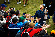 SOUTHPORT, ENGLAND - JULY 23:  Jordan Spieth of the United States celebrates with fans as he carries the Claret Jug around the 18th green during the final round of the 146th Open Championship at Royal Birkdale on July 23, 2017 in Southport, England. (Photo by Chris Condon/R&A/R&A/PGA TOUR via Getty Images)