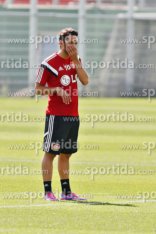 07.07.2014, BayArena, Leverkusen, GER, 1. FBL, Bayer 04 Leverkusen, Training, im Bild Sommer-Neuzugang vom Hamburger SV Hakan Calhanoglu nachdenklich bei seinem ersten Training // during a Trainingssession of German Bundesliga Club Bayer 04 Leverkusen at the BayArena in Leverkusen, Germany on 2014/07/07. EXPA Pictures &copy; 2014, PhotoCredit: EXPA/ Eibner-Pressefoto/ Schueler<br /> <br /> *****ATTENTION - OUT of GER*****