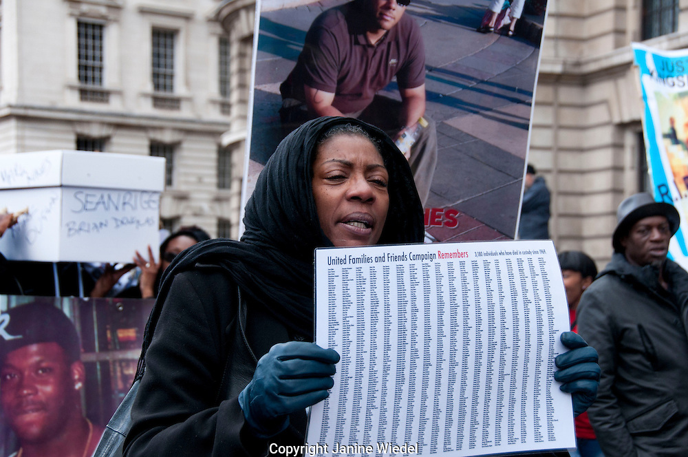 Marcia Rigg sister of Sean Rigg who died in custody 2008  holding names of those killed in police custody since 1969. 2012 London