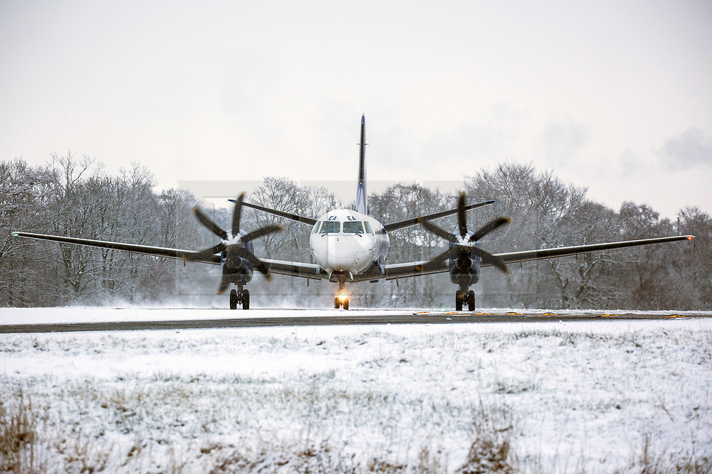 © Licensed to London News Pictures. 27/02/2018. Leeds UK. An aircraft prepares for take of in the snow this morning at Englands highest airport Leeds Bradford International in Yorkshire. Photo credit: Andrew McCaren/LNP