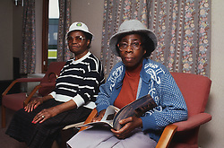 Two elderly women sitting in lounge of residential home,