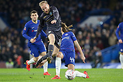 Sheffield Wednesday midfielder Barry Bannan (10)  rides a tackle from Chelsea Ethian Ampadu during the The FA Cup fourth round match between Chelsea and Sheffield Wednesday at Stamford Bridge, London, England on 27 January 2019.