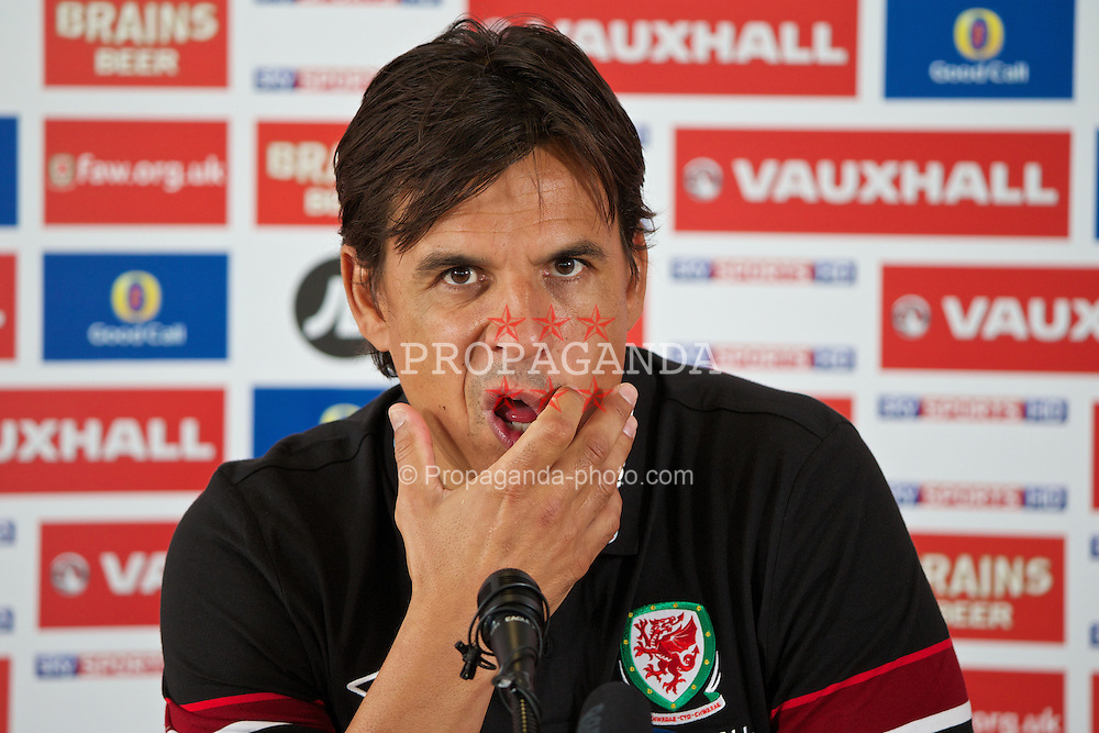 CARDIFF, WALES - Tuesday, August 13, 2013: Wales' manager Chris Coleman during a press conference at the St. David's Hotel ahead of the International Friendly match against the Republic of Ireland. (Pic by David Rawcliffe/Propaganda)