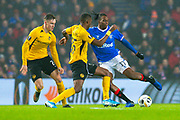 Joe Aribo (#17) of Rangers FC is tackles by Christopher Martins Pereira (#35) of BSC Young Boys during the Europa League Group G match between Rangers FC and BSC Young Boys at Ibrox Park, Glasgow, Scotland on 12 December 2019.