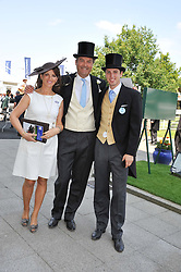 The HON.HARRY HERBERT, his wife CHICA and his nephew JAKE WARREN at the Investec Derby at Epsom Racecourse, Epsom Downs, Surrey on 4th June 2011.