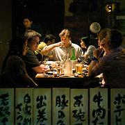 Diners at Kushi, an Izakaya and Sushi restaurant in downtown Washington, DC.