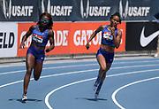 Jul 27, 2019; Des Moines, IA, USA; Morolake Akinosun (left) and English Gardner run in a women's 200m heat during the USATF Championships at Drake Stadium.