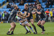 James Harrison (10) of Featherstone Rovers and Alex Susino (17) of Featherstone Rovers tackle Richard Lepori (2) of Swinton Lions during the Betfred Championship match between Featherstone Rovers and Halifax RLFC at the Big Fellas Stadium, Featherstone, United Kingdom on 9 February 2020.
