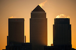 © Licensed to London News Pictures. 07/03/2016. London, UK. The Sun rises from behind Canary Wharf, the banking district of London on a clear morning on March 07, 2016. Photo credit: Ben Cawthra/LNP