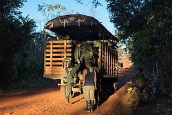El Diamante, Meta, Colombia - 15.09.2016        <br /> <br /> Some guerilla fighters leave with a truck to another camp. 10th conference of the marxist FARC-EP in El Diamante, a Guerilla controlled area in the Colombian district Meta. Few days ahead of the peace contract passing after 52 years of war with the Colombian Governement wants the FARC decide on the 7-days long conferce their transformation into a unarmed political organization. <br /> <br /> Einige Kaempfer fahren auf einer LKW Ladeflaeche zu einem anderen Camp. Zehnte Konferenz der marxistischen FARC-EP in El Diamante, einem von der Guerilla kontrollierten Gebiet im kolumbianischen Region Meta. Wenige Tage vor der geplanten Verabschiedung eines Friedensvertrags nach 52 Jahren Krieg mit der kolumbianischen Regierung will die FARC auf ihrer sieben taegigen Konferenz die Umwandlung in eine unbewaffneten politischen Organisation beschlieflen. <br />  <br /> Photo: Bjoern Kietzmann