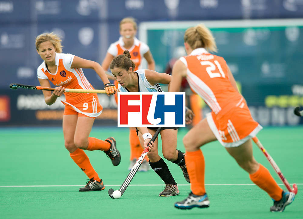 Argentina's Rosario Luchetti gets away from the Dutch defenders Wieke Dijkstra and Sophie Polkamp during their Women's Champions Trophy Final at Highfields, Beeston, Nottingham, 18th July 2010.
