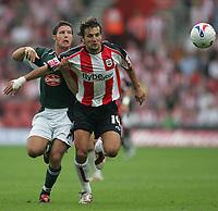 Photo: Lee Earle.<br /> Southampton v Plymouth Argyle. Coca Cola Championship. 16/09/2006. Plymouth's David Norris (L) battles with Inigo Idiakez.