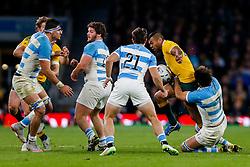Australia replacement Kurtley Beale is tackled by Argentina Flanker Juan Martin Fernandez Lobbe - Mandatory byline: Rogan Thomson/JMP - 07966 386802 - 25/10/2015 - RUGBY UNION - Twickenham Stadium - London, England - Argentina v Australia - Rugby World Cup 2015 Semi Finals.