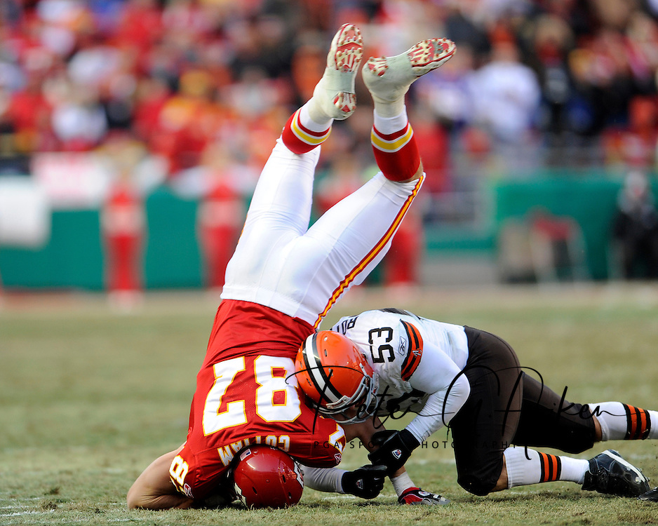 December 20, 2009:  Tight end Brad Cottam #87 of the Kansas City Chiefs gets upended after making a first down catch in the fourth quarter against linebacker Matt Roth #53 of the Cleveland Browns at Arrowhead Stadium in Kansas City, Missouri.  The Browns defeated the Chiefs 41-34...