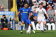 AFC Wimbledon striker Andy Barcham (17) dribbling and battles for possession with Northampton Town defender Aaron Phillips (18) during the EFL Sky Bet League 1 match between AFC Wimbledon and Northampton Town at the Cherry Red Records Stadium, Kingston, England on 11 March 2017. Photo by Matthew Redman.