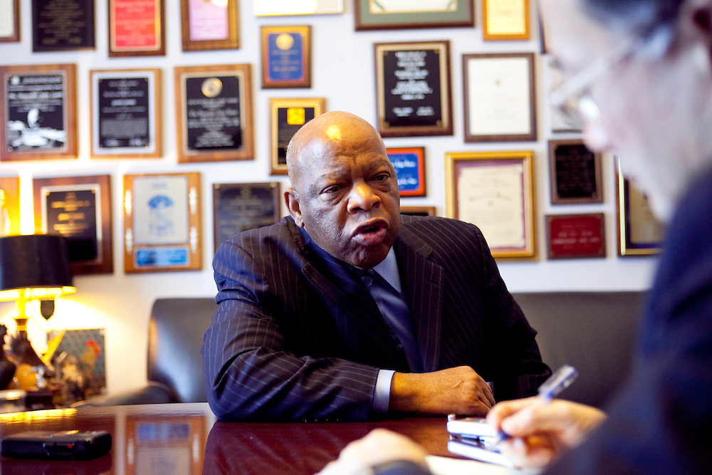 Rep. John Lewis (D-GA), left, sits for an interview in his office on Capitol Hill with Hiroki Sugita of the Kyodo News Agency on Tuesday, Apr. 21, 2009 in Washington, DC.