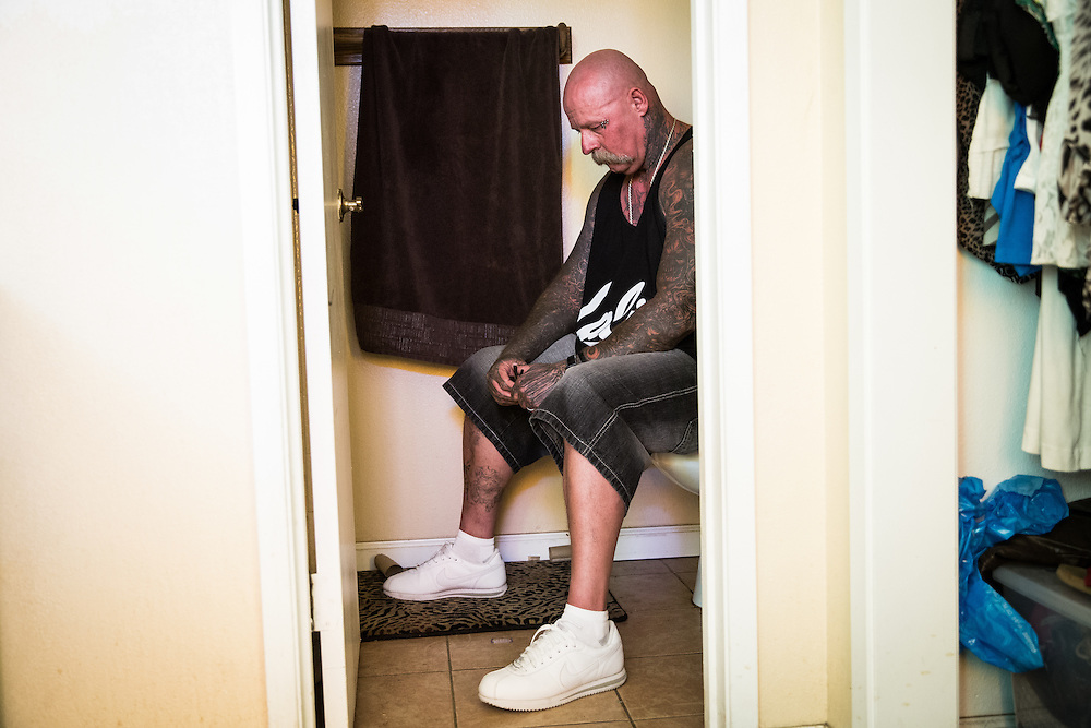 STOCKTON, CA - JULY 27, 2015:  Joseph Harmon poses for a portrait in his bathroom, where he occasionally retreats to when anxious, because it feels similar to solitary confinement – a place he feels most comfortable. Harmon spent eight years in solitary confinement at Pelican Bay State Prison. CREDIT: Max Whittaker for The New York Times
