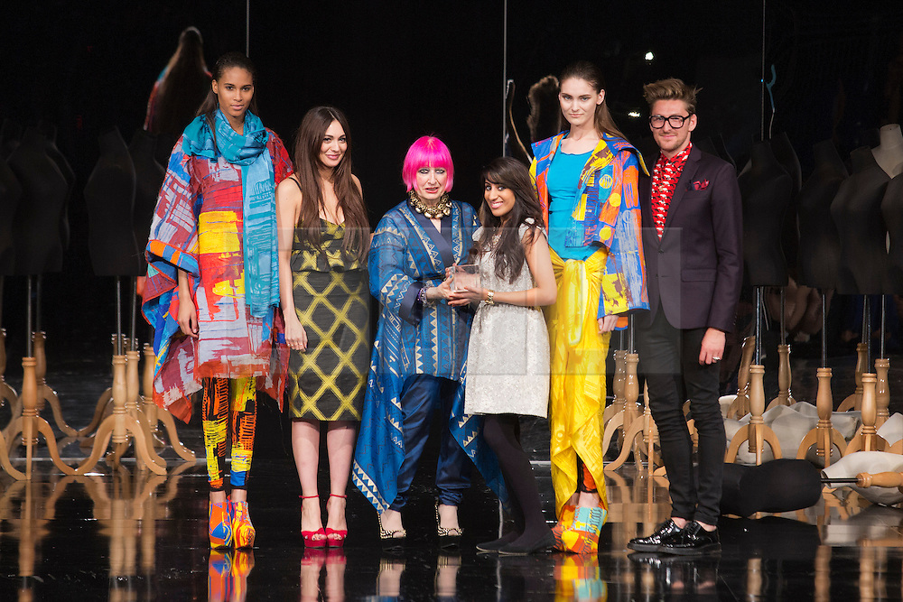 © Licensed to London News Pictures. 05/06/2013. London, England. KIRANDEEP BASSAN of Northamptn University wins the Zandra Rhodes Catwalk Textile Award. Pictured with L-R: Zara Martin, Zandra Rhodes and Henry Holland. Award winners of Graduate Fashion Week 2013. Photo credit: Bettina Strenske/LNP