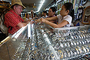Ben Tanh Market. Selling fake designer wristwatches to tourists.