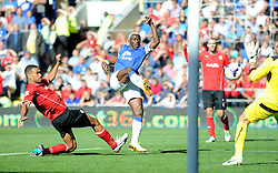 Everton's Arouna Kone shoots inside the box but Cardiff City's David Marshall saves it.  - Photo mandatory by-line: Alex James/JMP - Tel: Mobile: 07966 386802 31/08/2013 - SPORT - FOOTBALL - Cardiff City Stadium - Cardiff - Cardiff City V Everton - Barclays Premier League