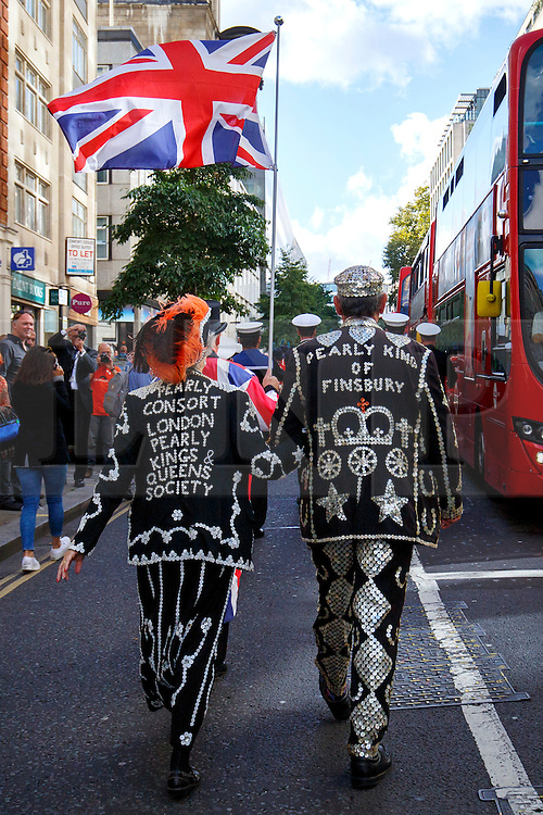 © Licensed to London News Pictures. 25/09/2016. London, UK. Pearly Kings and Queens parade through the streets of city of London to St Mary Le Bow Church for a service of thanksgiving in London as they continue 140-year-old Pearly tradition on 25 September 2016 during Pearly Harvest Festival. Dressed in dark suits covered in hundreds of bright pearl buttons, the Pearly Kings and Queens of London follow the charity tradition of Henry Croft, an orphan who worked as a street sweeper in the market of Somers Town, London in the 19th century. Photo credit: Tolga Akmen/LNP