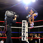 Dagoberto Aguero of San Cristobal, Dominican Republic leaps over the top rope to enter the ring for his match against Gustavo Molina of Mexico during a Nelsons Promotions boxing match at the Boca Raton Resort  and Club on Friday, May 26, 2017 in Boca Raton, Florida.  (Alex Menendez via AP)
