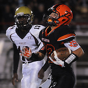 New Hanover High School's Keegan Santos rushes Ashley High School's Caleb Parker Friday October 10, 2014 at Legion Stadium in Wilmington, N.C. (Jason A. Frizzelle)