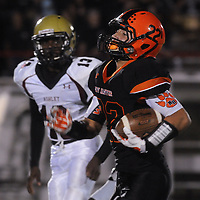 New Hanover High School's Keegan Santos rushes Ashley High School's Caleb Parker Friday October 10, 2014 at Legion Stadium in Wilmington, N.C. (Jason A. Frizzelle)
